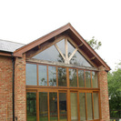 Oak roof trusses and glazed gable
