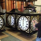 Fitting out pillar clock dial boxes in our factory